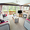 The Castaway holiday home - lounge with outlook doors onto covered veranda